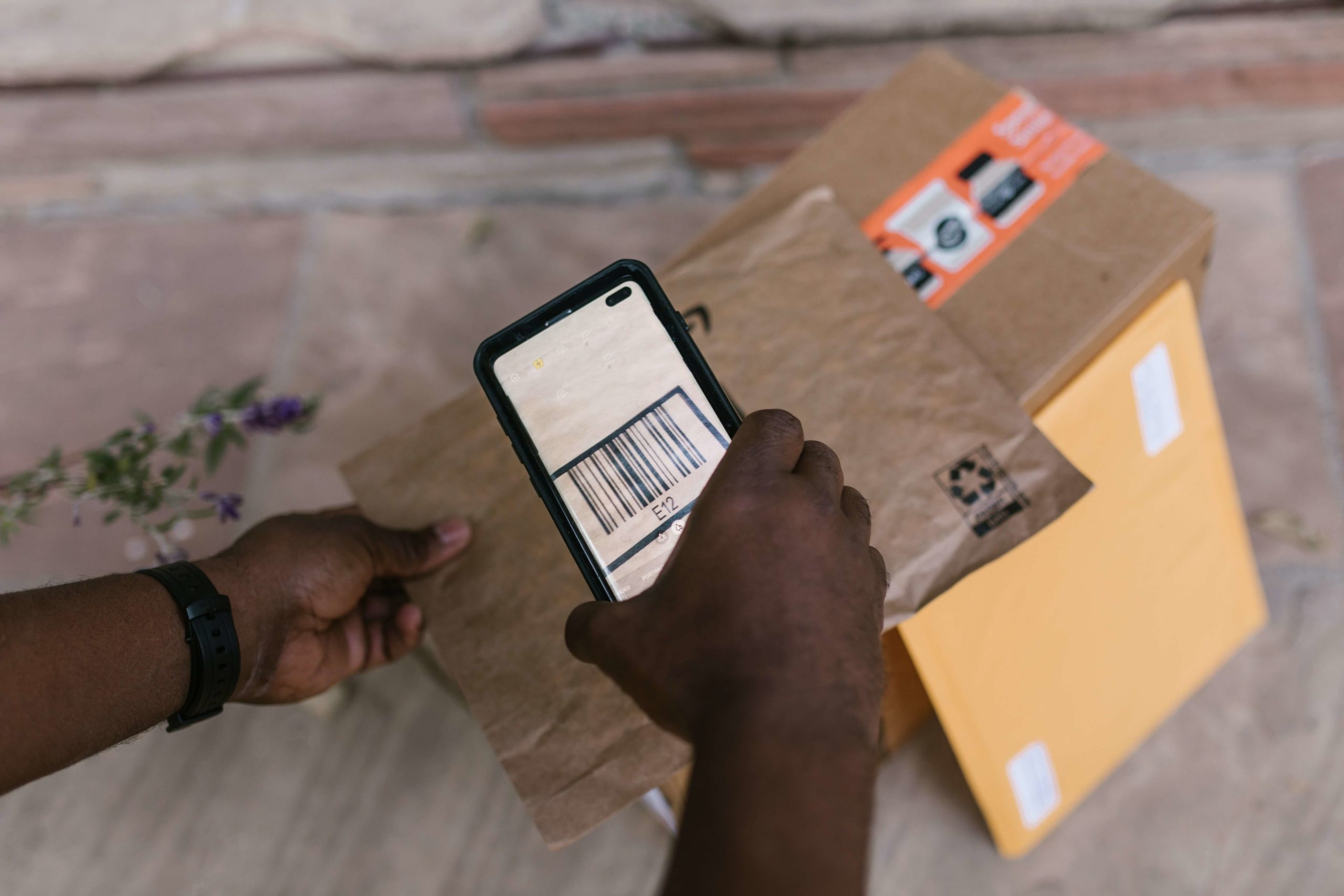 Scanning the barcode on the parcel via the phone